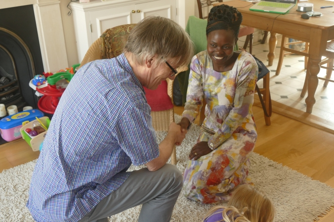 Ceremonial meeting of in-laws, Ugandan-style. Bart welcomes Valentina, eldest brother Patrick's wife